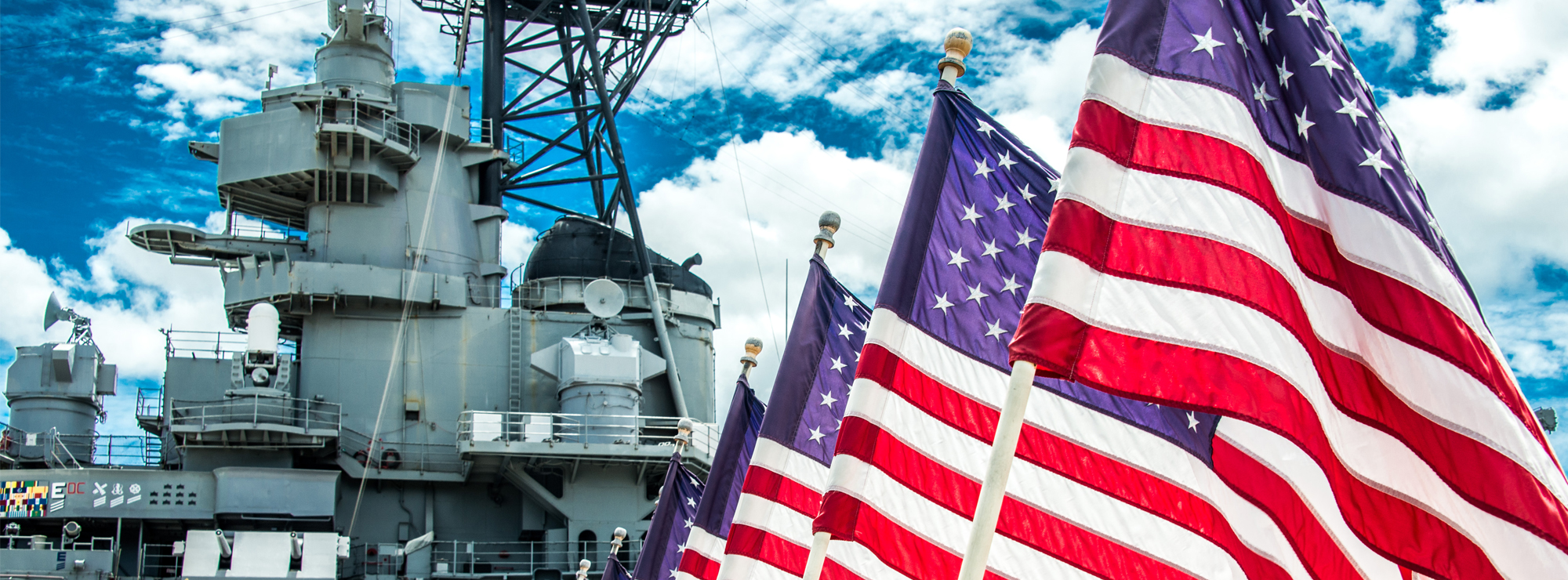 American flags in front of a battleship bridge